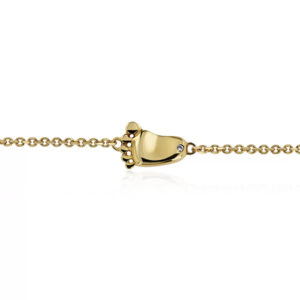 yellow gold bracelet with aby feet and engraved diamond stone