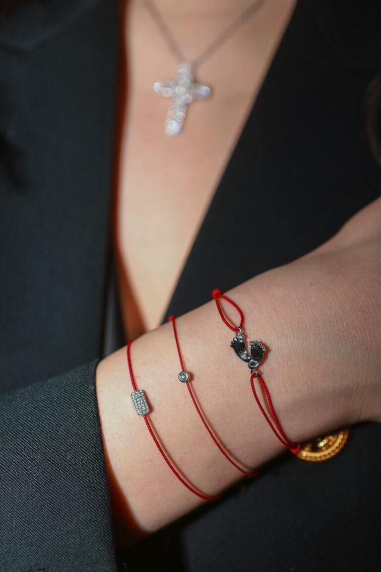 Delicate red string bracelet